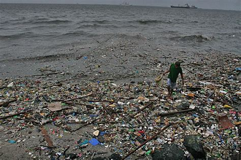 Trash washes up on Roxas Boulevard from Manila Bay after rain
